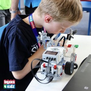 UPLOADING 1 / 1 – Boy and Robot in our workshops and programs with lego®.jpg ATTACHMENT DETAILS Boy and Robot in our workshops and programs with lego®